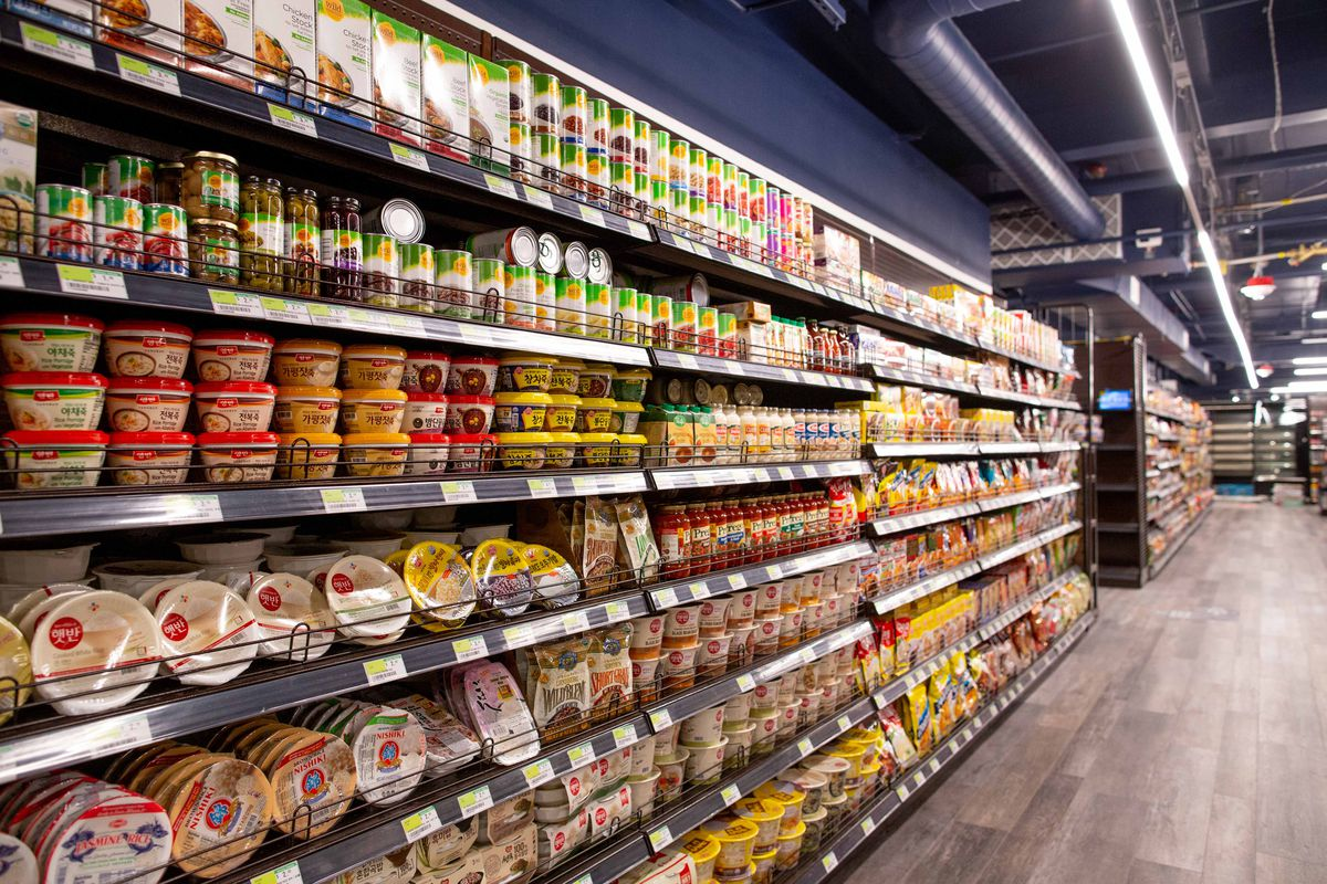 A row of shelves at H Mart displaying a variety of dry goods.