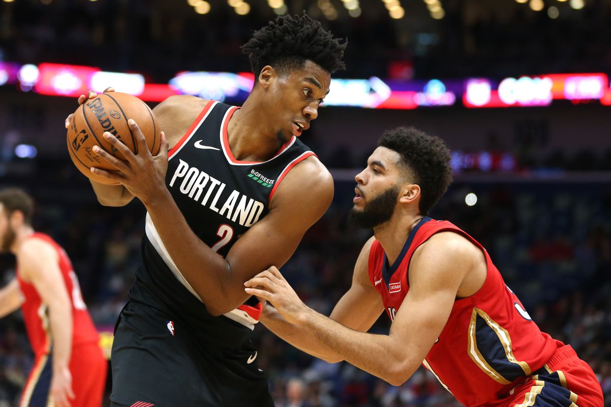 Portland Trail Blazers center Hassan Whiteside controls the ball defended by New Orleans Pelicans guard Kenrich Williams in the second half at the Smoothie King Center.