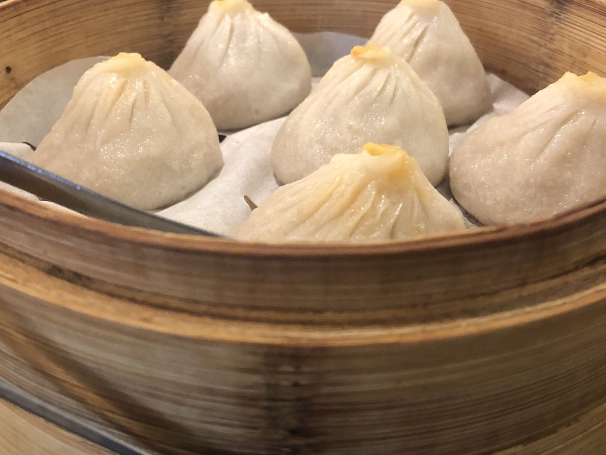 Crab soup dumplings sit in a steamer at Real Kung Fu Little Steamed Buns