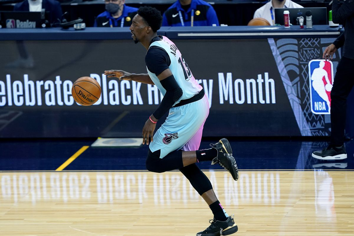 Bam Adebayo #13 of the Miami Heat dribbles the ball up court against the Golden State Warriors during the second half of an NBA basketball game at Chase Center on February 17, 2021 in San Francisco, California.