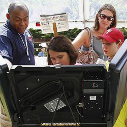 Children are shown an electronic voting machine during Carolina Fest, Monday, Sept. 3, 2012, in Charlotte, N.C., before the Democratic National Convention.