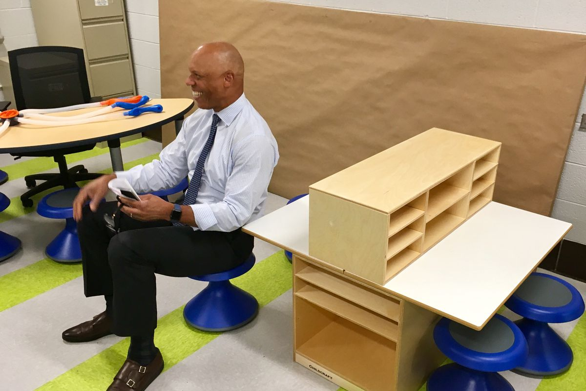 Superintendent William Hite sitting on a wobble seat and smiling.