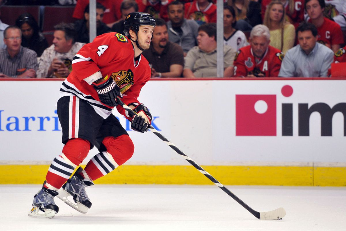 Mar 21, 2012; Chicago, IL, USA; Chicago Blackhawks defenseman Niklas Hjalmarsson (4) skates with the puck against the Vancouver Canucks during the first period at the United Center.  Mandatory Credit: Rob Grabowski-US PRESSWIRE