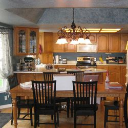BEFORE:  This is a good example of how an outdated kitchen can be transformed with an updated style with a remodel.