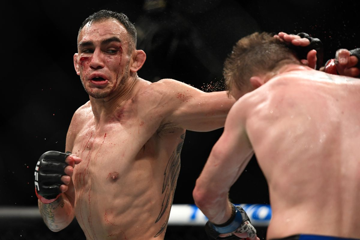 Tony Ferguson of the United States looks to punch Justin Gaethje of the United States in their Interim lightweight title fight during UFC 249 at VyStar Veterans Memorial Arena on May 9, 2020 in Jacksonville, Florida.