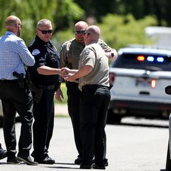 Law enforcement officers are seen at the scene of an officer-involved shooting on Jackson Avenue in Ogden on Thursday, May 28, 2020.
