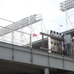 11:55 a.m. The end of the left-field back fence, just before the temporary location of the video board -