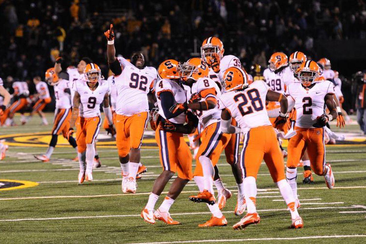 November 17, 2012; Columbia, MO, USA; The Syracuse Orange celebrate their upset victory over the Missouri Tigers at Faurot Field. The Syracuse Orange defeated the Missouri Tigers 31-27. Mandatory Credit: Dak Dillon-US PRESSWIRE