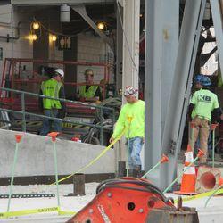 2:26 p.m. Work inside the main bleacher entrance -