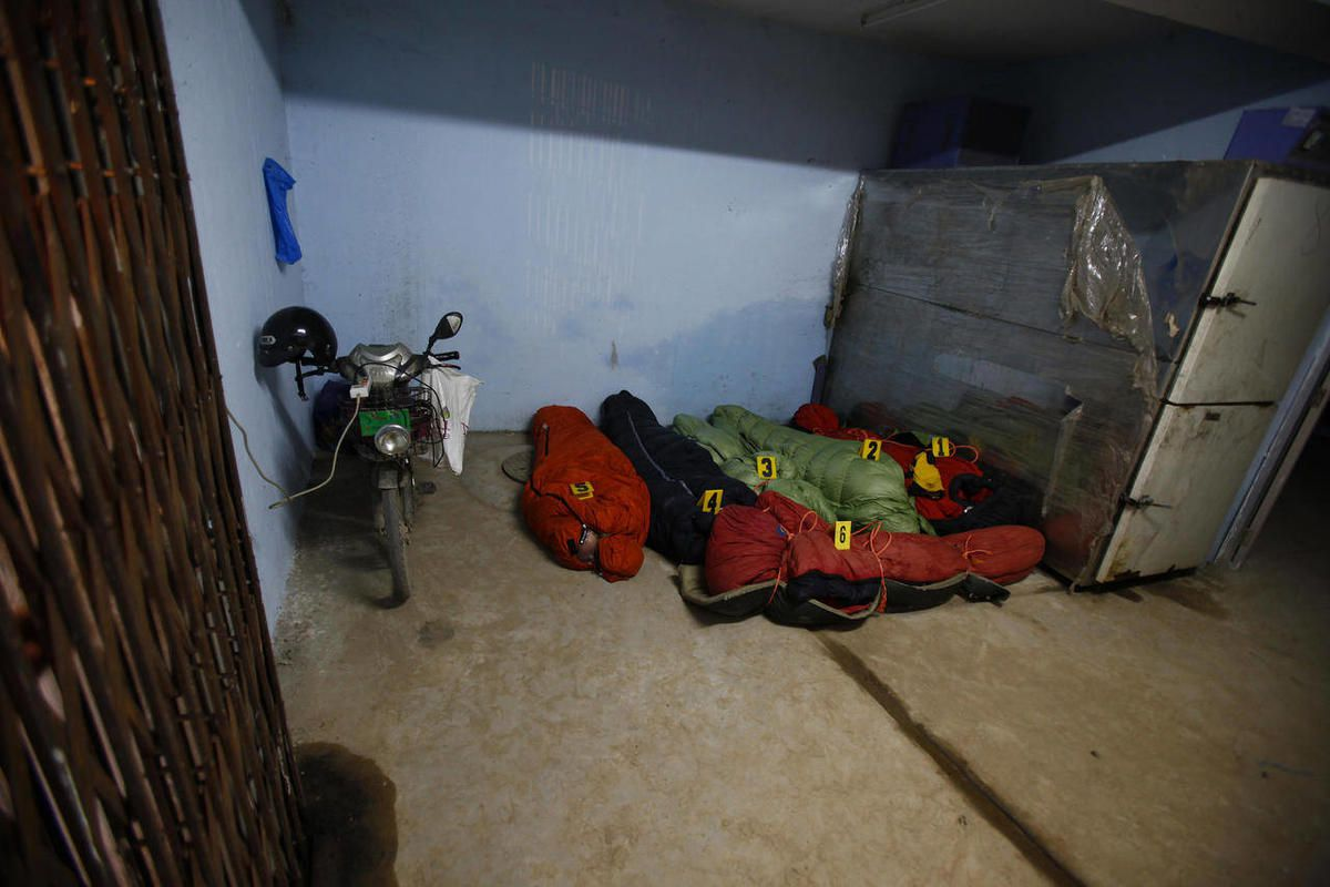 Bodies of climbers killed in an avalanche at Mount Manaslu lie covered with numbers at the Tribhuvan University Teaching hospital in Katmandu, Nepal, Monday, Sept. 24, 2012. Rescue helicopters flew over the high slopes of a northern Nepal peak again Monda