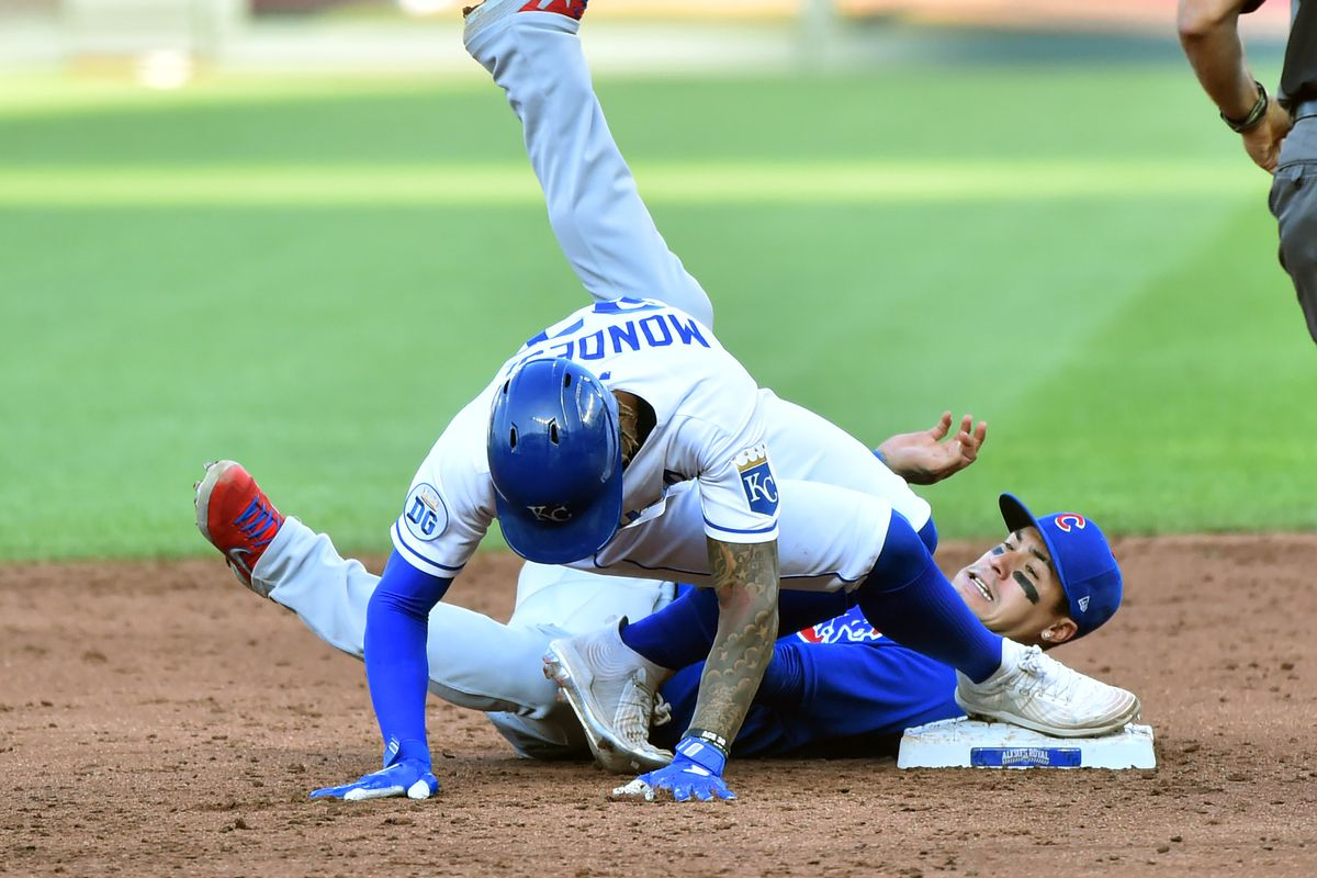Adalberto Mondesi #27 of the Kansas City Royals slides into second for a double past the tage of Javier Baez #9 of the Chicago Cubs in the third inning at Kauffman Stadium on August 06, 2020 in Kansas City, Missouri.