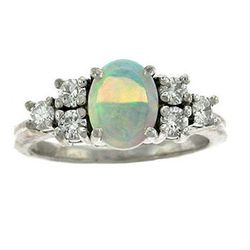 """<strong>E.B. Horn</strong> 14kt White Gold Opal and Diamond Ring, <a href=""""http://www.ebhorn.com/item/14kt-white-gold-opal-diamond-ring?return=%2Fcatalog%2Fjewelry-rings#"""">$450</a>"""