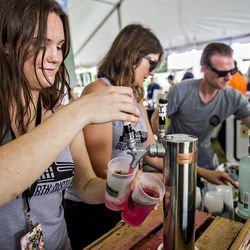 The crew from Old Fourth Distillery pouring drinks in the tasting tents.