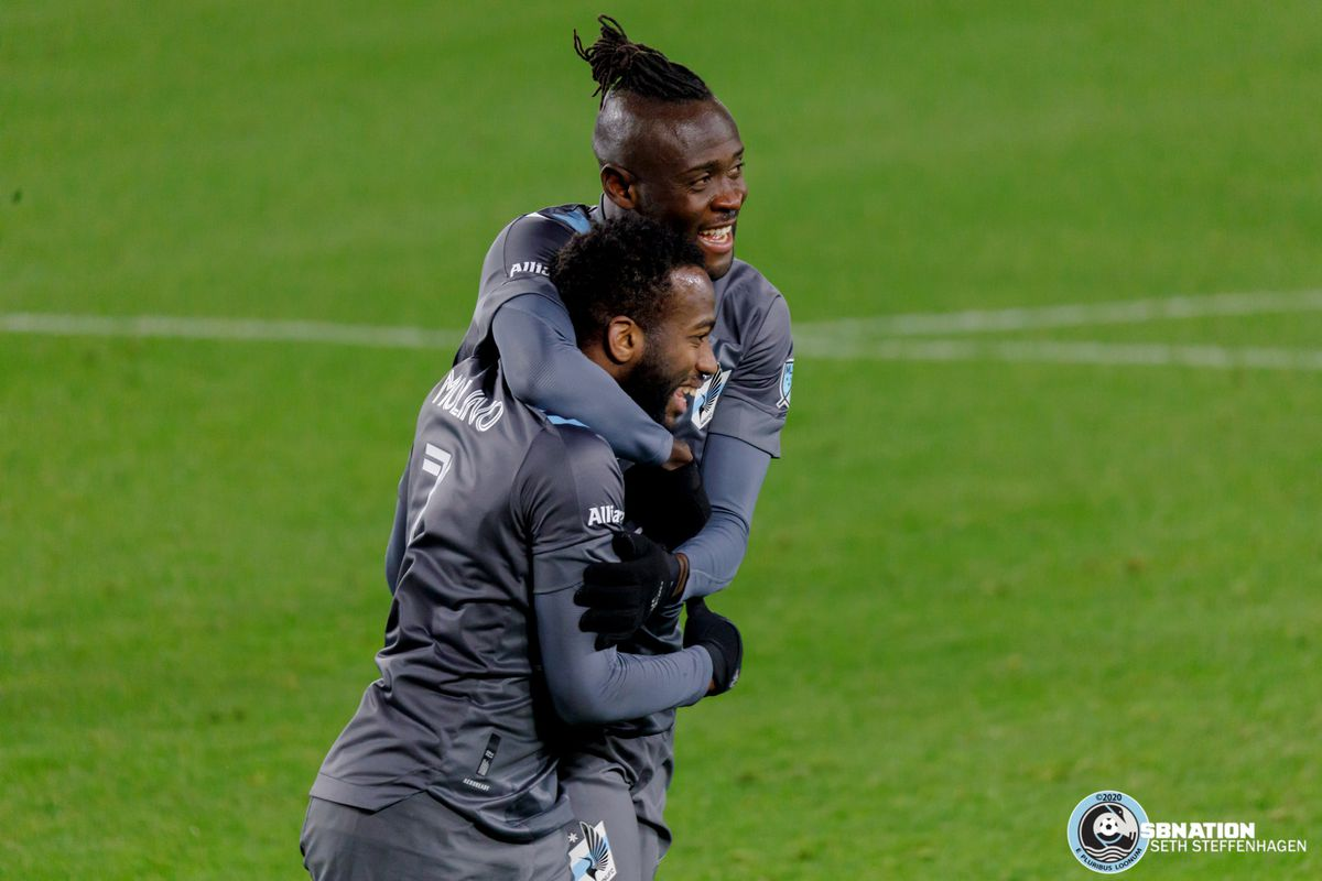 November 22, 2020 - Saint Paul, Minnesota, United States - Minnesota United midfielder Kevin Molino (7) scores a second goal and celebrates with fellow Loon Kei Kamara (16) during the first round playoff match against the Colorado Rapids at Allianz Field.