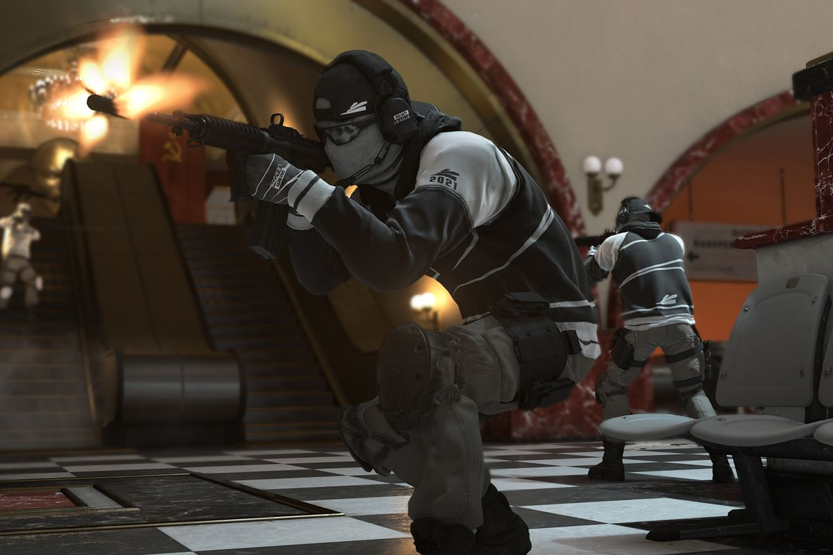A Call of Duty League player stands in a station defending a point from enemy players