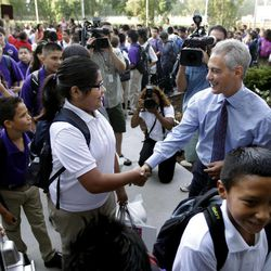 Chicago Mayor Rahm Emanuel and Alderman Ed Burke, greet students as they enter Shields Middle School on their first day back to school, Tuesday, Sept. 4, 2012, in Chicago.