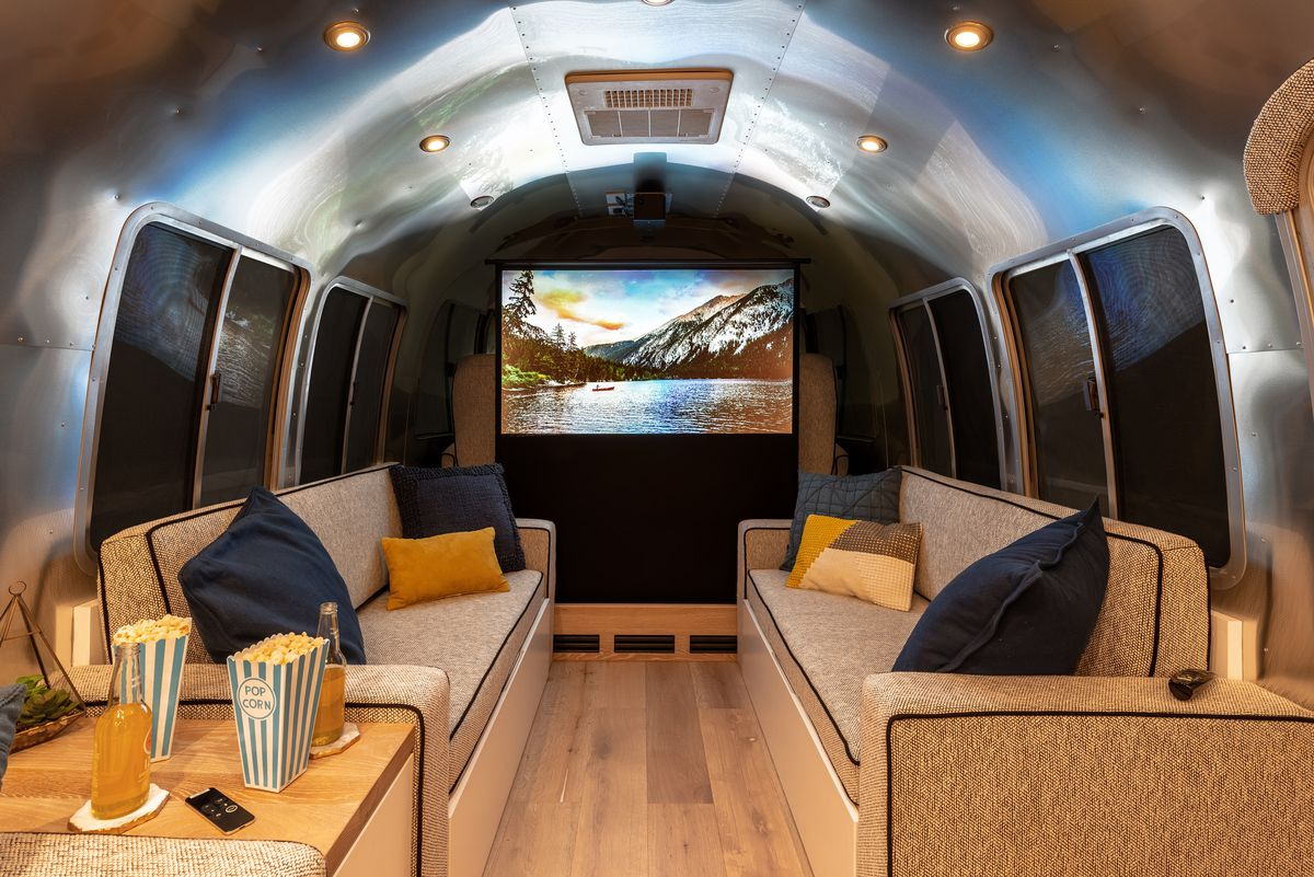A projection screen pops up for epic movie nights in the trailer.