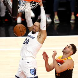 Memphis Grizzlies forward Dillon Brooks (24) gets a dunk over Utah Jazz forward Georges Niang (31) as the Utah Jazz and Memphis Grizzlies play Game 2 of their NBA playoffs first round series at Vivint Arena in Salt Lake City on Wednesday, May 26, 2021. Utah won 141-129.