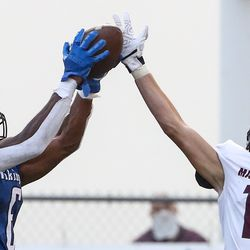 Pleasant Grove wide receiver Darrius Clemons, left, grabs a touchdown pass over the outstretched hand of Maple Mountain defender Ethan Davis during a football game at Pleasant Grove High School in Pleasant Grove on Friday, Aug. 21, 2020.