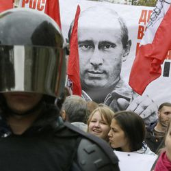 """Protesters hold a poster depicting Russia's President Vladimir Putin as they march during a protest rally in St. Petersburg, Russia, Saturday, Sept. 15, 2012. The sign reads: """"Prices, tariffs and poverty rise, you chose all this"""".  Thousands of protesters marched across downtown Moscow  and St. Petersburg on Saturday in the first major rally in three months against President Vladimir Putin, while defying the Kremlin's ongoing efforts to crackdown on opposition."""