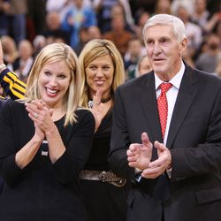 Former Utah Jazz coach Jerry Sloan and his wife Tammy clap as his banner is unveiled in his honor during halftime of the Utah Jazz game in Salt Lake City Friday, Jan. 31, 2014.