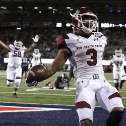 New Mexico State running back Larry Rose III (3) reacts after scoring a touchdown in overtime to defeat Utah State in the Arizona Bowl NCAA college football game, Friday, Dec. 29, 2017, in Tucson, Ariz. (AP Photo/Rick Scuteri)