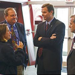 John Swallow, the GOP candidate for the 2nd Congressional District, talks to Dave Hebertson, a concerned voter and Chad E. Bennion at Hollywood Connection in West Valley before a meet-the-candidate hour.