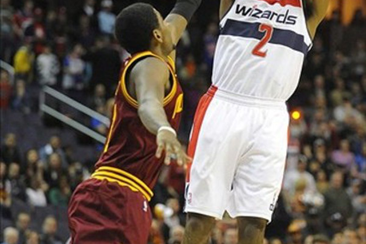 Mar 3, 2012; Washington, DC, USA; Washington Wizards point guard John Wall (2) shoots the ball over Cleveland Cavaliers point guard Kyrie Irving (2) during the first half at the Verizon Center. Mandatory Credit: Brad Mills-US PRESSWIRE