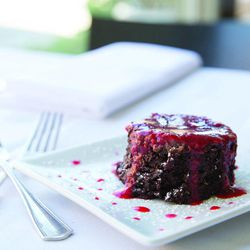 """Molten Chocolate Pots with Raspberry Sauce from Em's Restaurant in """"Salt Lake City Chef's Table: Extraordinary Recipes from The Crossroads of the West."""""""