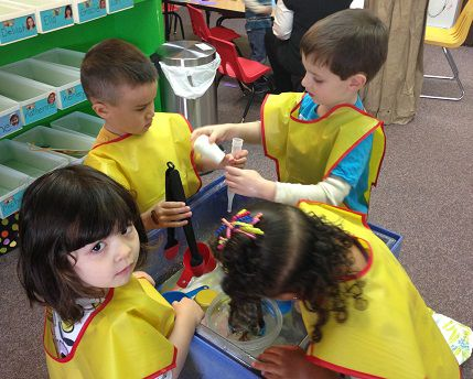 Children play at the water table during free play at Promise Christian Preschool.