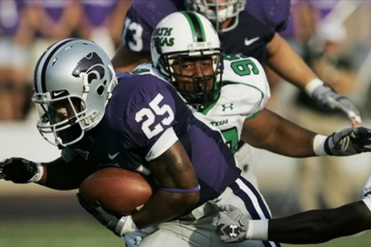 AP Photo  Kansas State running back Keithen Valentine (25) gets past North Texas defenders for a touchdown during the first quarter of a football game in Manhattan, Kan., Saturday, Aug. 30, 2008.