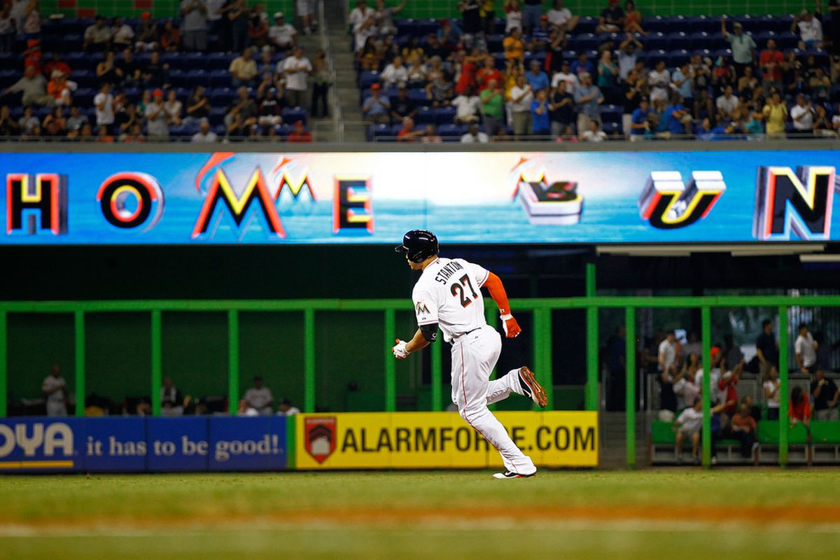 MIAMI, FL - JUNE 26: Giancarlo Stanton #27 of the Miami Marlins hits a home run during a game against the St. Louis Cardinals at Marlins Park on June 26, 2012 in Miami, Florida.  (Photo by Mike Ehrmann/Getty Images)