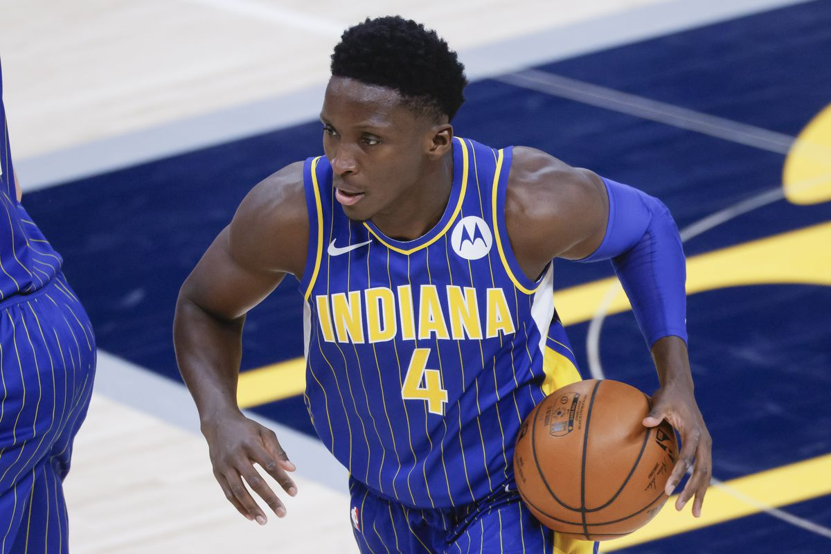 Victor Oladipo of the Indiana Pacers dribbles the ball during the game against the Phoenix Suns at Bankers Life Fieldhouse on January 9, 2021 in Indianapolis, Indiana.