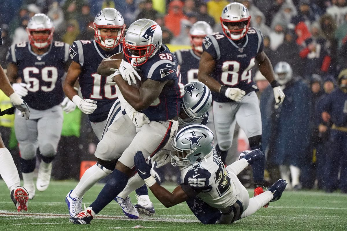 New England Patriots running back Sony Michel runs the ball against Dallas Cowboys defensive back Josh Jones and free safety Xavier Woods in the second half at Gillette Stadium. Patriots defeated the Cowboys 13-9.