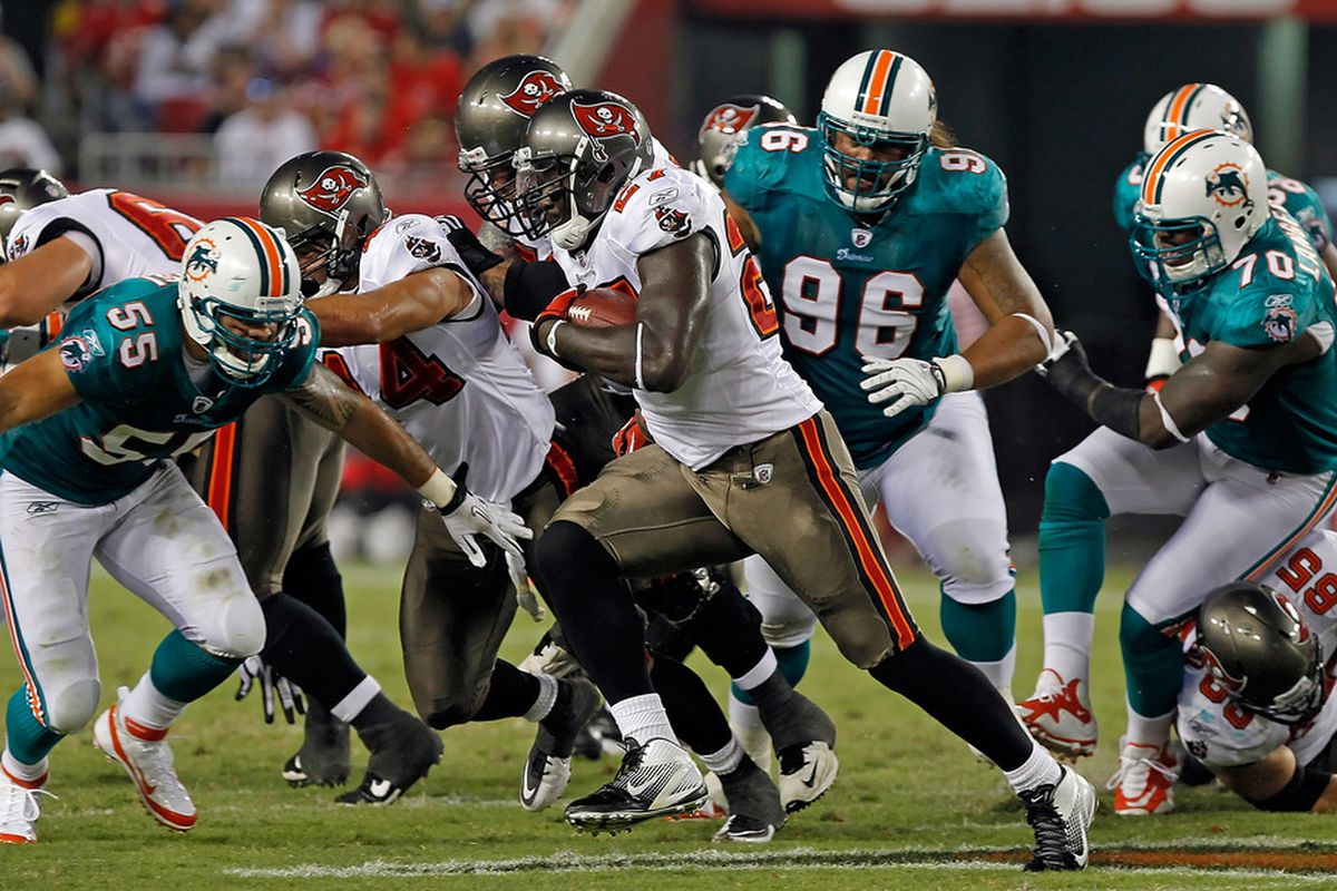TAMPA, FL - AUGUST 27:  Running back LeGarrette Blount #27 of the Tampa Bay Buccaneers runs the ball against the Miami Dolphins during a preseason game at Raymond James Stadium on August 27, 2011 in Tampa, Florida.  (Photo by J. Meric/Getty Images)
