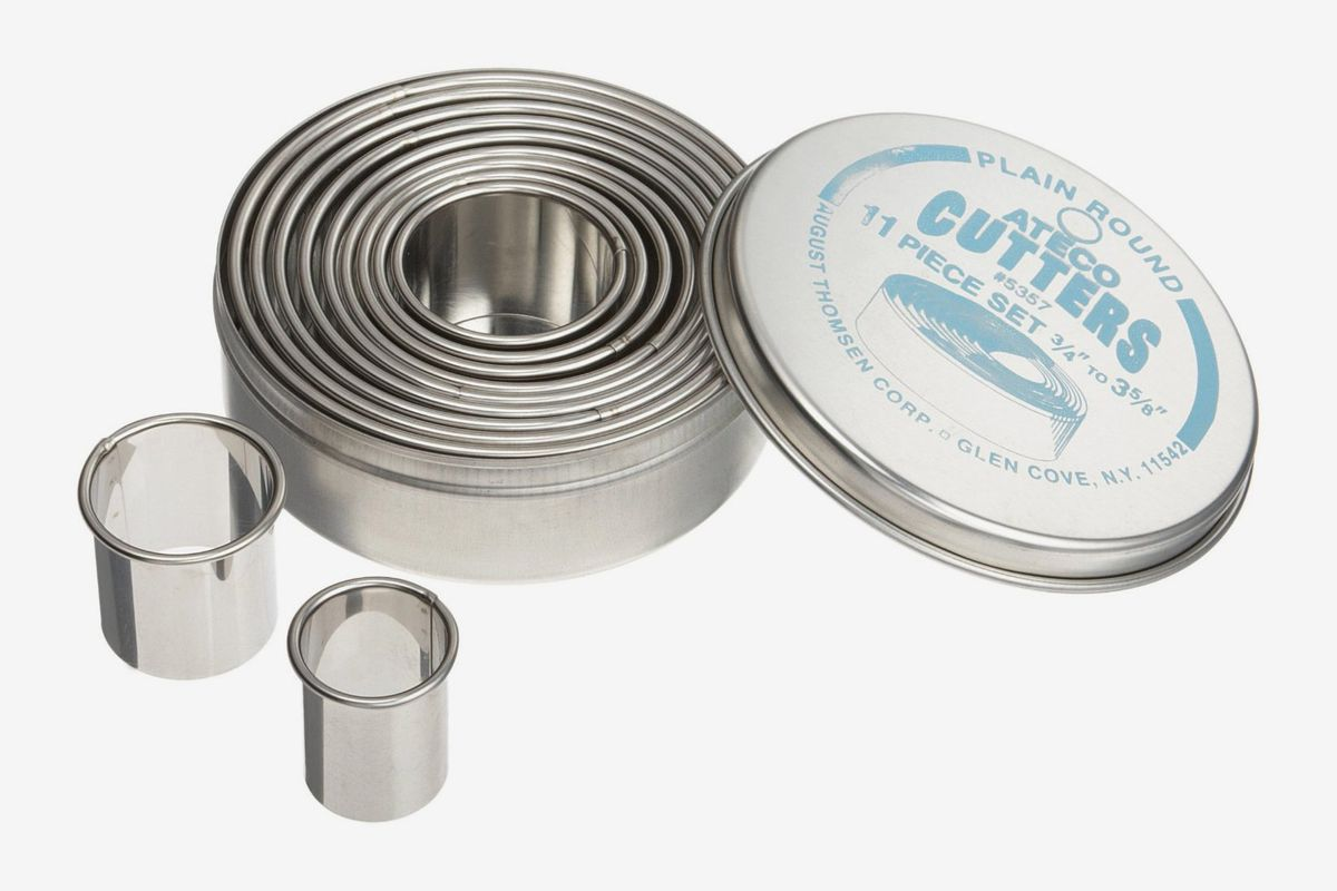 11 assorted stainless-steel round cutters in a container