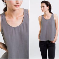 """<b>Izzy Grinspan, Racked Editorial Director</b>: """"The best lightweight option for tops I've found is <b>Everlane's</b> <a href=""""https://www.everlane.com/collections/womens-tops/products/womens-silk-tank-slate"""">silk tank</a> ($55). It's loose but not exces"""