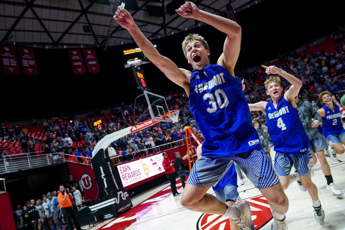 Fremont's Dallin Hall and teammates celebrate their win over Davis in the 6A boys basketball championship game at the Huntsman Center in Salt Lake City on Saturday, Feb. 29, 2020.