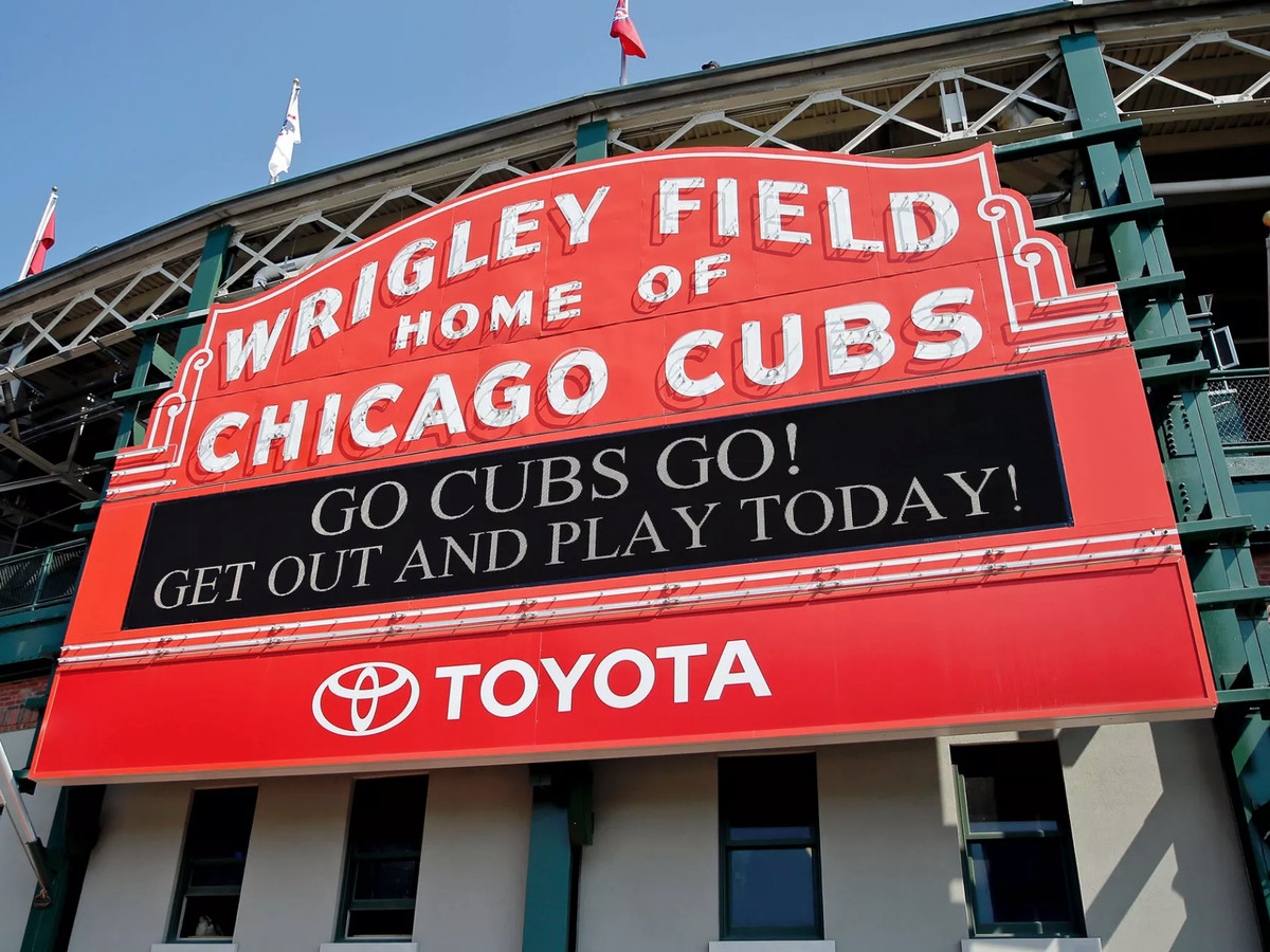 A photo of the red Wrigley Field marquee with the text: Wrigley Field Home of Chicago Cubs.