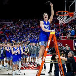 Fremont's Dallin Hall clips the net as he and teammates celebrate their win over Davis in the 6A boys basketball championship game at the Huntsman Center in Salt Lake City on Saturday, Feb. 29, 2020.