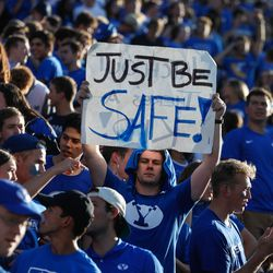 Fans gather ahead of an NCAA college football game between BYU and Utahat LaVell Edwards Stadium in Provo on Saturday, Sept. 11, 2021.