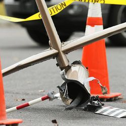 A piece of debris from the crashed helicopter. Emergency crews respond Tuesday, Dec. 2, 2014, to a helicopter crash in North Salt Lake.