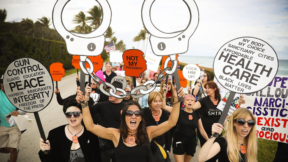 Anti-Trump protestors on the one year anniversary of the President's inauguration in Palm Beach, Florida, on January 20, 2018.