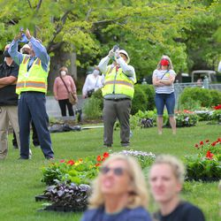 Workers from Jacobsen Construction gather to watch as their company prepares to remove the Angel Moroni statue from the Salt Lake Temple of The Church of Jesus Christ of Latter-day Saints in Salt Lake City on Monday, May 18, 2020.