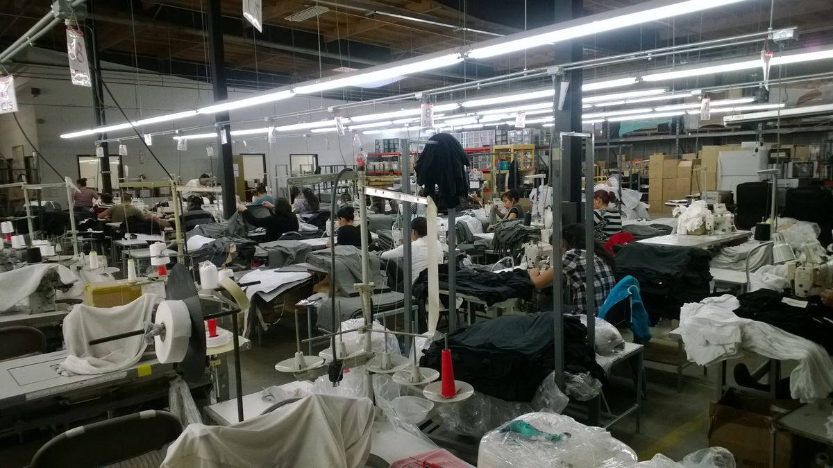 Garment workers at a Los Angeles factory make clothing for Everlane in 2015.