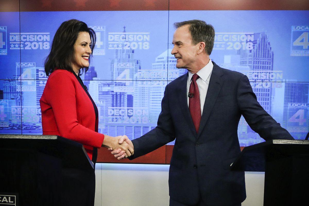 Democrat Gretchen Whitmer and Republican Bill Schuette shake hands before their second debate, in Detroit, Michigan, on October 24, 2018.
