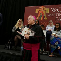 Archbishop Charles J. Chaput, O.F.M. Cap., Archdiocese of Philadelphia, thanks Elder D. Todd Christofferson of the Quorum of the Twelve Apostles of The Church of Jesus Christ of Latter-day Saints, for speaking at the World Meeting of Families in Philadelphia on Thursday, Sept. 24, 2015.