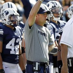 Brigham Young Cougars head coach Bronco Mendenhall raises his fist as Brigham Young University faces Idaho State in NCAA football in Provo, Saturday, Oct. 22, 2011.