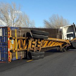 An truck overturned by the wind, on the frontage road in Farmington, Thursday, Dec. 1, 2011.
