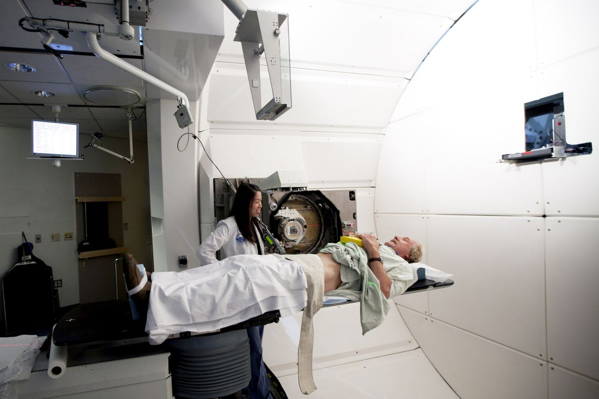 A patient is prepared for proton-beam therapy, a controversially expensive new treatment for certain cancers